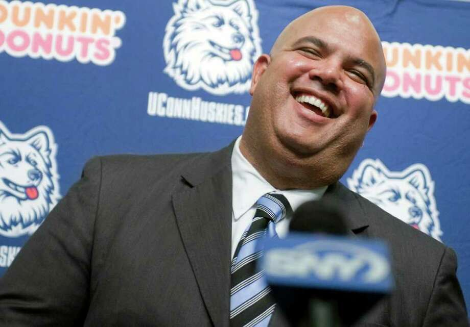 Warde Manuel smiles as he is introduced as the new athletic director for the University of Connecticut at a news conference in Storrs, Conn., Monday, Feb. 13, 2012.   (AP Photo/Jessica Hill) Photo: Jessica Hill, Associated Press / AP2012