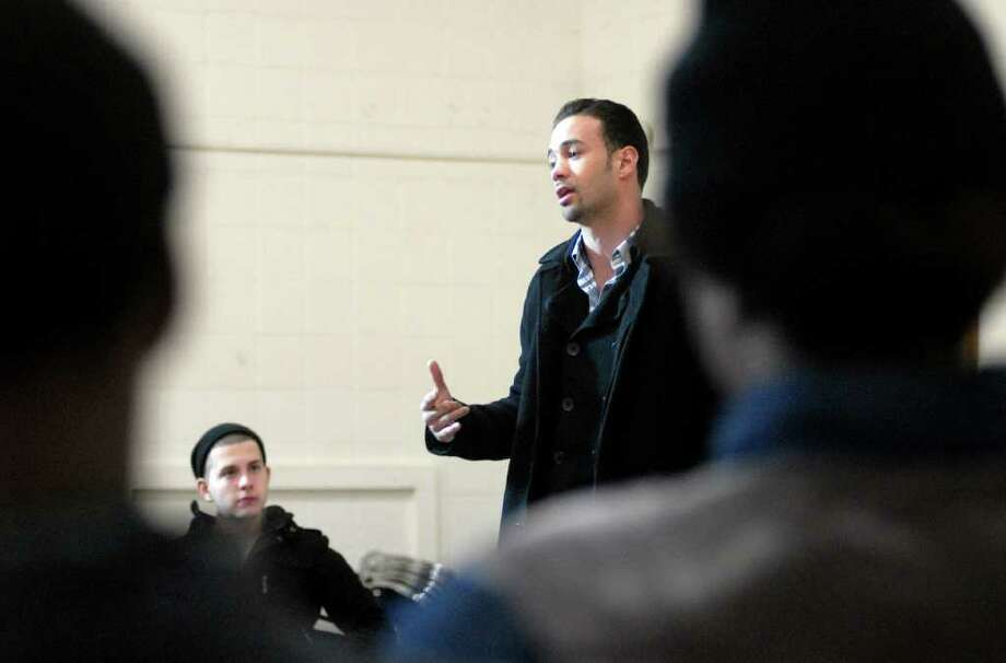 George Tsartsabalidis listens to Delvin Rodriguez speak to students at Waterside ARTS Program in Stamford, Conn. on Monday February 13, 2012.  Rodriguez is the current IBF Champion of the World as well as a CT resident. Photo: Dru Nadler / Stamford Advocate Freelance