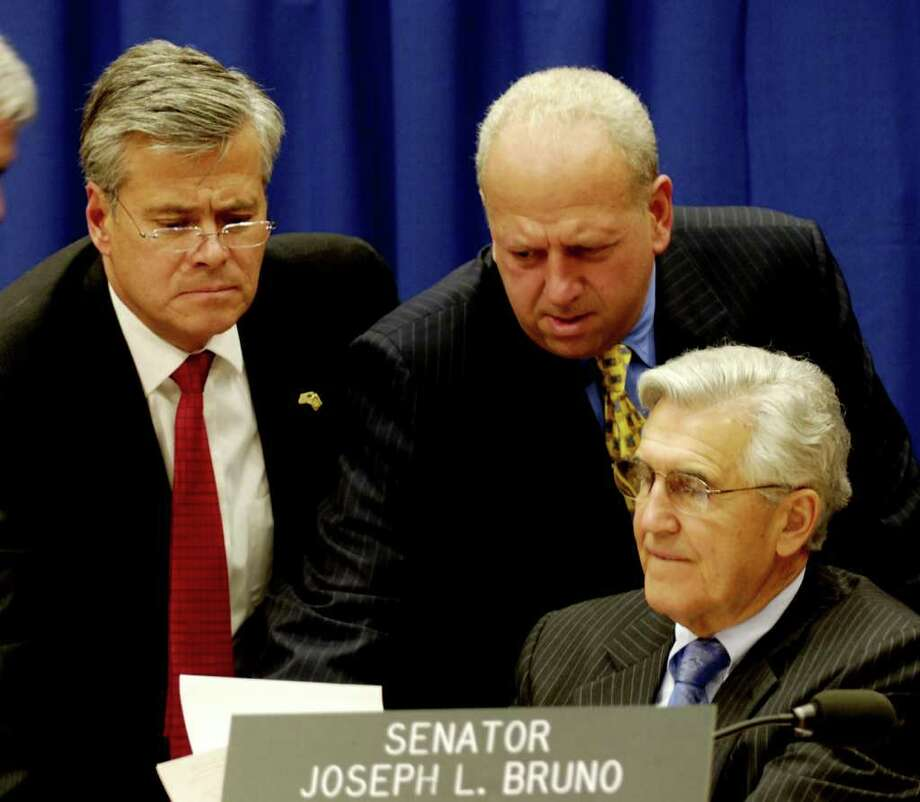 TIMES UNION STAFF PHOTO BY SKIP DICKSTEIN - Senate Majority Leader Joseph Bruno (R) speaks with Senators Dean Skelos (L) and Nick Spano (C) during a break period of the General Conference on the budget held in the Legislative Office Building Conference Room B this afternnoon March 28, 2006. Photo: SKIP DICKSTEIN / ALBANY TIMES UNION