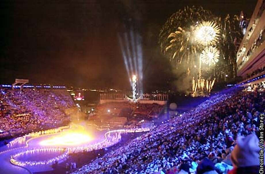 Fireworks explode over Rice-Eccles stadium after the lighting of the Olympic cauldron. The 2002 Winter Olympics takes place in Salt Lake City, Utah. John Storey/The Chronicle Photo: John Storey