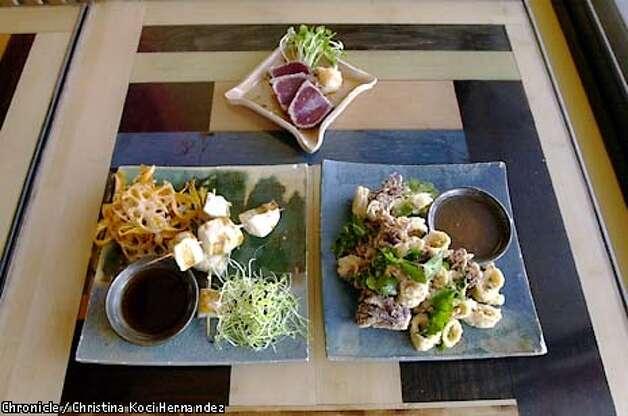 Grasshopper: The restaurant serves Asian small plates such as tuna tataki (left) and fried calamari. / Christina Koci Hernandez / The Chronicle 2001