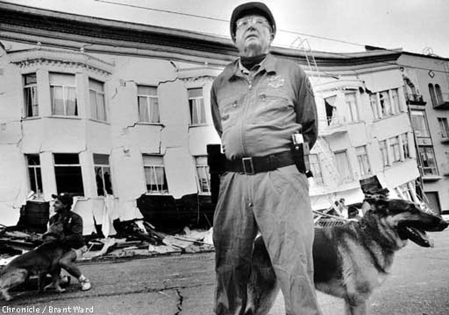 Police stand guard with dogs in the Marina District, in San Francisco, after the 1989 earthquake. CHRONICLE PHOTO BY BRANT WARD