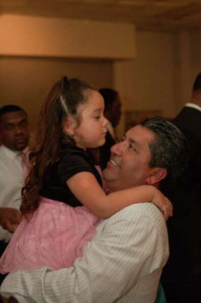 Madie Diaz, 3, shares a moment with dad Leobardo Diaz at the Missouri City Princess Ball.  Photo by