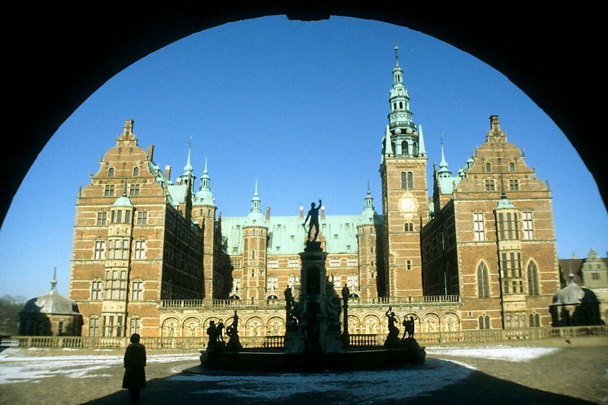 Walking up to Frederiksborg Castle, you can almost hear the clopping of royal hooves as you pass over several moats.