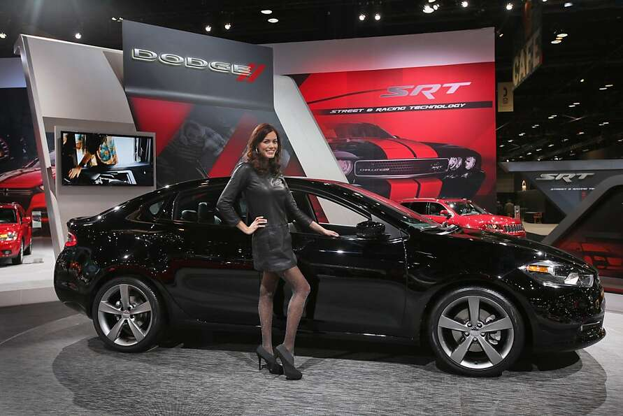 CHICAGO, IL - FEBRUARY 08: Julie Etheridge helps Dodge show off the new Dart during the media previe