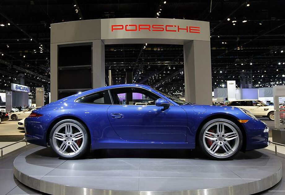 Porsche introduces a 2012 Porsche 911 Carrera S during the media preview of the Chicago Auto Show at McCormick Place in Chicago on Wednesday, Feb. 8, 2012. (AP photo/Nam Y. Huh) Photo: Nam Y. Huh, Associated Press