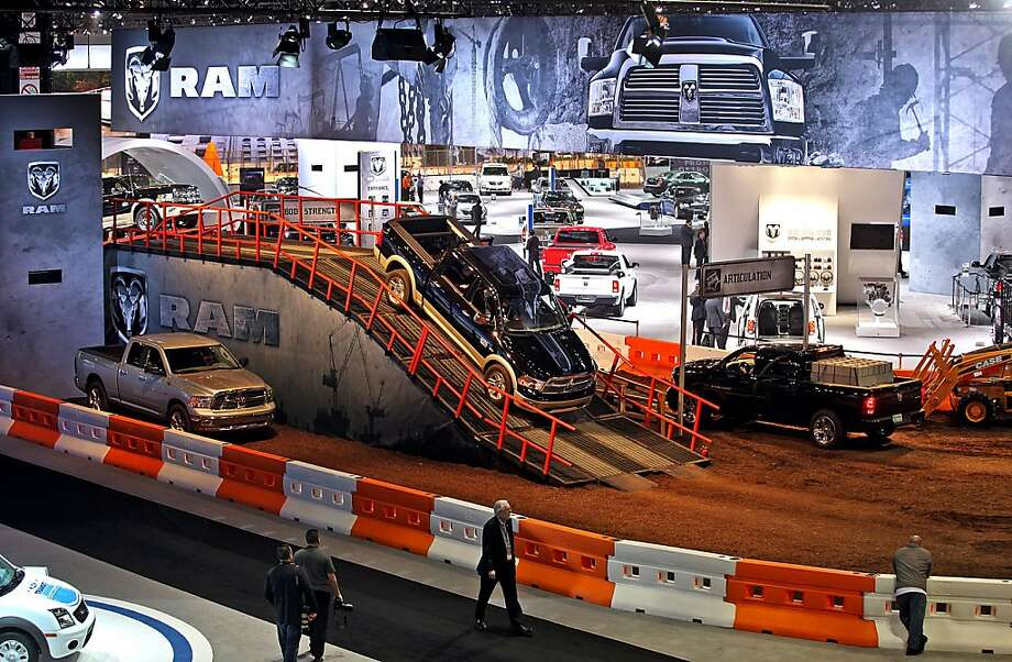 Attendees view the Chrysler Group LLC Dodge Ram exhibit during a media preview for the 2012 Chicago Auto Show in Chicago, Illinois, U.S., on Wednesday, Feb.8, 2012. The show, which is open to the public from Feb. 10-19, will have almost 1,000 vehicles on display. Photographer: Tim Boyle/Bloomberg Photo: Tim Boyle, Bloomberg