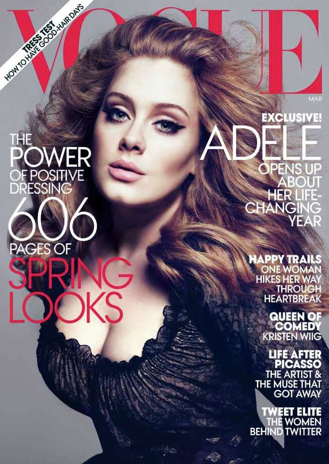 "In this magazine cover image photographed by Mert Alas and Marcus Piggott and released by Vogue, singer Adele is shown on the cover of the March issue of ""Vogue.""  The singer vows to ""never"" write a breakup record again and adds she's ""done being a bitter witch."" (AP Photo/Vogue) Photo: Mert Alas And Marcus Piggott"