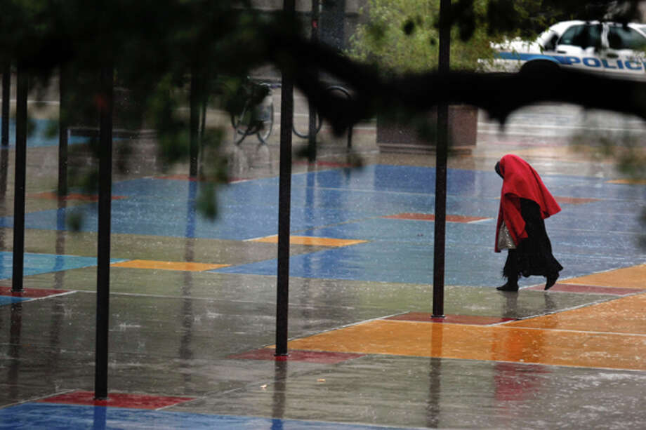 A woman enters downtown's Houston Central Library. Photo: Johnny Hanson, File Photo / Houston Chronicle