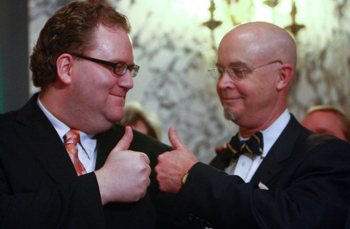 State Rep. Marko Liias, left, give a thumbs-up with House Speaker pro-tem, Rep. Jim Moeller, before Gov. Chris Gregoire signs a bill legalizing gay marriage in Washington  on Monday at the Legislative Building of the Washington State Capitol in Olympia.