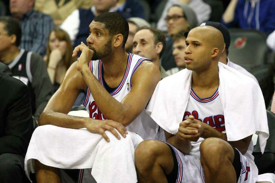 NEWARK, NJ - FEBRUARY 11:  (L-R) Tim Duncan #21 and Richard Jefferson #24 of the San Antonio Spurs look on from the bench against the New Jersey Nets at Prudential Center on February 11, 2012 in Newark, New Jersey.  NOTE TO USER: User expressly acknowledges and agrees that, by downloading and or using this photograph, User is consenting to the terms and conditions of the Getty Images License Agreement.  (Photo by Chris Chambers/Getty Images) *** Local Caption *** Tim Duncan; Richard Jefferson Photo: Chris Chambers, Getty Images / 2012 Getty Images