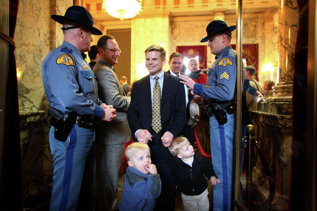 State Rep. Jamie Pedersen leaves a ceremony with his sons Anders, 2, and Leif, 2, after a bill was signed legalizing gay marriage in Washington State on Monday February 13, 2012 at the Legislative Building of the Washington State Capitol in Olympia. Pedersen and his partner Eric have two other young sons. Photo: JOSHUA TRUJILLO / SEATTLEPI.COM