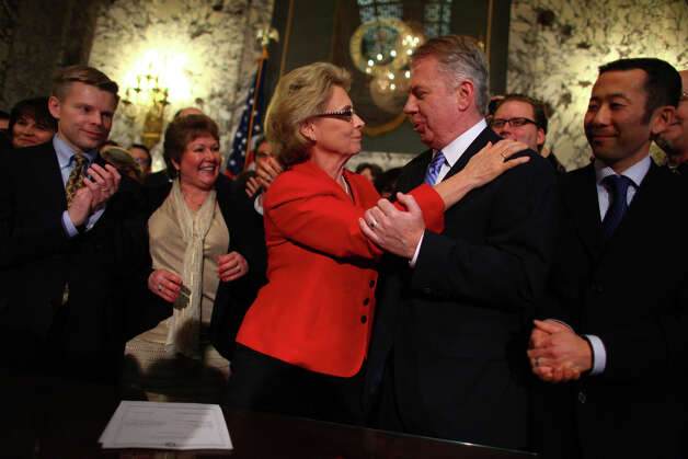 Governor Chris Gregoire hugs Sen. Ed Murray after signing a bill legalizing gay marriage in Washington State on Monday February 13, 2012 at the Legislative Building of the Washington State Capitol in Olympia. Photo: JOSHUA TRUJILLO / SEATTLEPI.COM