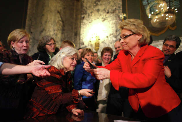 Governor Chris Gregoire hands out pens after signing a bill legalizing gay marriage in Washington State on Monday February 13, 2012 at the Legislative Building of the Washington State Capitol in Olympia. Photo: JOSHUA TRUJILLO / SEATTLEPI.COM