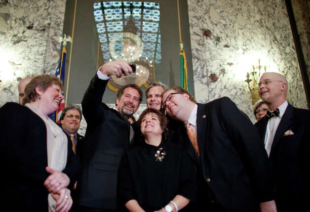 Members of the Washington State legislature take a photo before the signing of a bill legalizing gay marriage in Washington State on Monday February 13, 2012 at the Legislative Building of the Washington State Capitol in Olympia. Photo: JOSHUA TRUJILLO / SEATTLEPI.COM