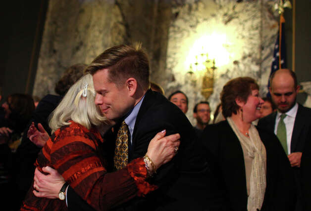 Rep. Jamie Pedersen gets a hug after the signing of a bill legalizing gay marriage in Washington State on Monday February 13, 2012 at the Legislative Building of the Washington State Capitol in Olympia. Photo: JOSHUA TRUJILLO / SEATTLEPI.COM