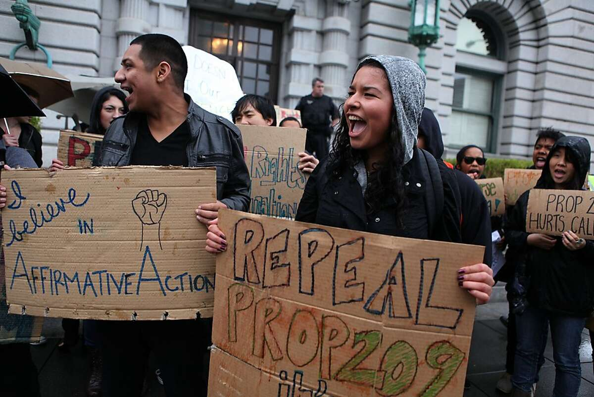 UC Berkeley students Sidronio Jacobo (left) and Diana Rosendo (right) protesting in front of the Ninth U.S. Circuit Court of Appeals in San Francisco, Calif., on Monday, February 13, 2011. The court is hearing a new lawsuit challenging Proposition 209, the 1996 initiative that banned affirmative action based on race or sex in state and local government employment and education.