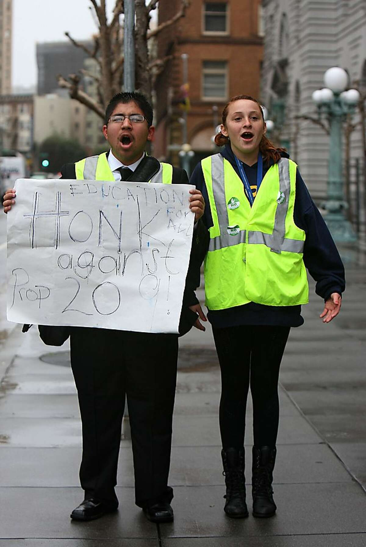 UC Berkeley students Juan M. Heredia (left) and Karly Behncke (right) protesting in front of the Ninth U.S. Circuit Court of Appeals in San Francisco, Calif., on Monday, February 13, 2011. The court is hearing a new lawsuit challenging Proposition 209, the 1996 initiative that banned affirmative action based on race or sex in state and local government employment and education.