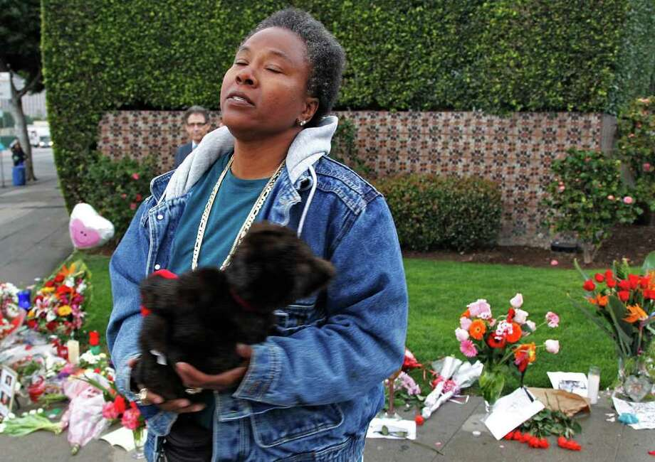"Pauline Hayes, sings Whitney Houston's song ""I Wanna to Dance with Somebody"" at a memorial for Houston outside the Beverly Hills Hilton Hotel where Houston died. Photo: Associated Press"