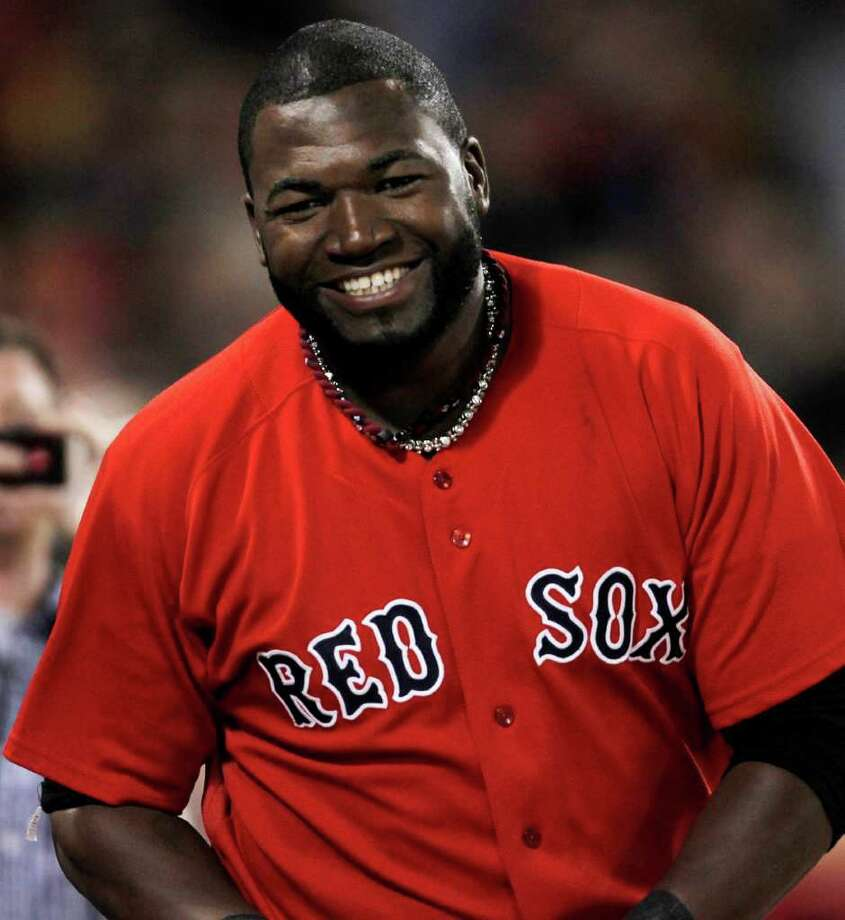 FILE - In this June 3, 2011 file photo, Boston Red Sox's David Ortiz laughs during the eighth inning of Boston's 8-6 win over the Oakland Athletics in a baseball game at Fenway Park in Boston. The Red Sox announced Monday, Feb. 13, 2012 that Ortiz and the  Red Sox avoided salary arbitration and agreed to a one-year contract worth $14,575,000. (AP Photo/Winslow Townson, File) Photo: Winslow Townson