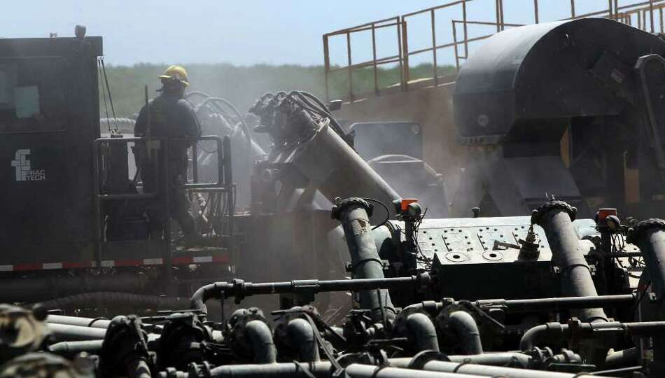 Dust permeates the air at a Chesapeake Energy Co. fracking operation at a well site near Carrizo Spr