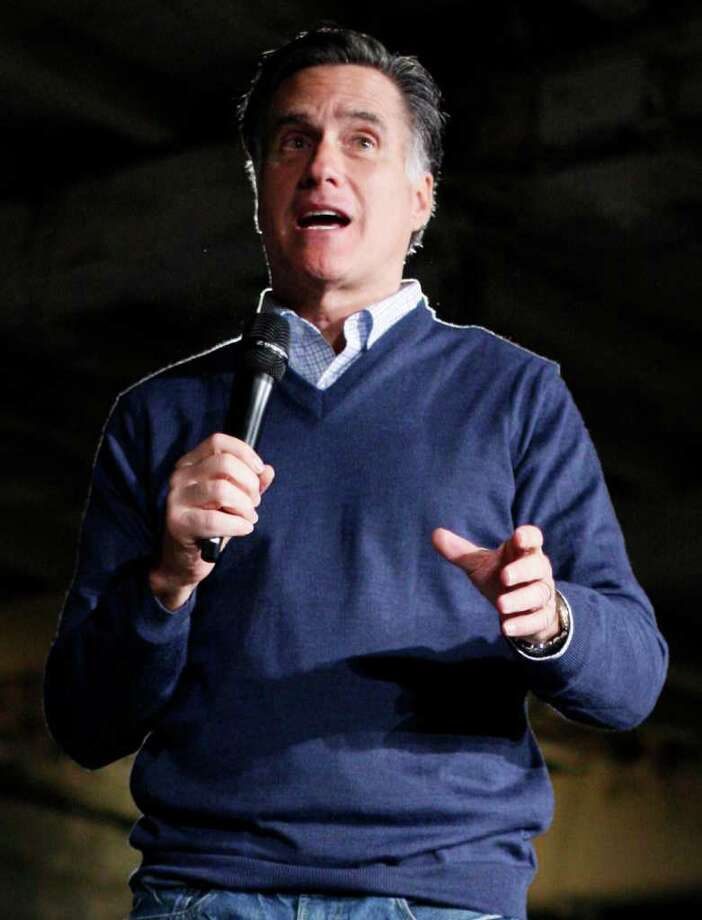 FILE - In this Feb. 10, 2012 file photo, Republican presidential candidate Mitt Romney speaks in Portland, Maine. Romney accepted nearly $280,000 in contributions raised by a former lobbyist for Fannie Mae, despite the GOP candidate's blistering criticism of the mortgage giant. Romney and other Republicans haven't identified other so-called fundraising ?bundlers,? leaving voters in the dark about who their campaigns are indebted to.  (AP Photo/Robert F. Bukaty, File) Photo: Robert F. Bukaty / AP