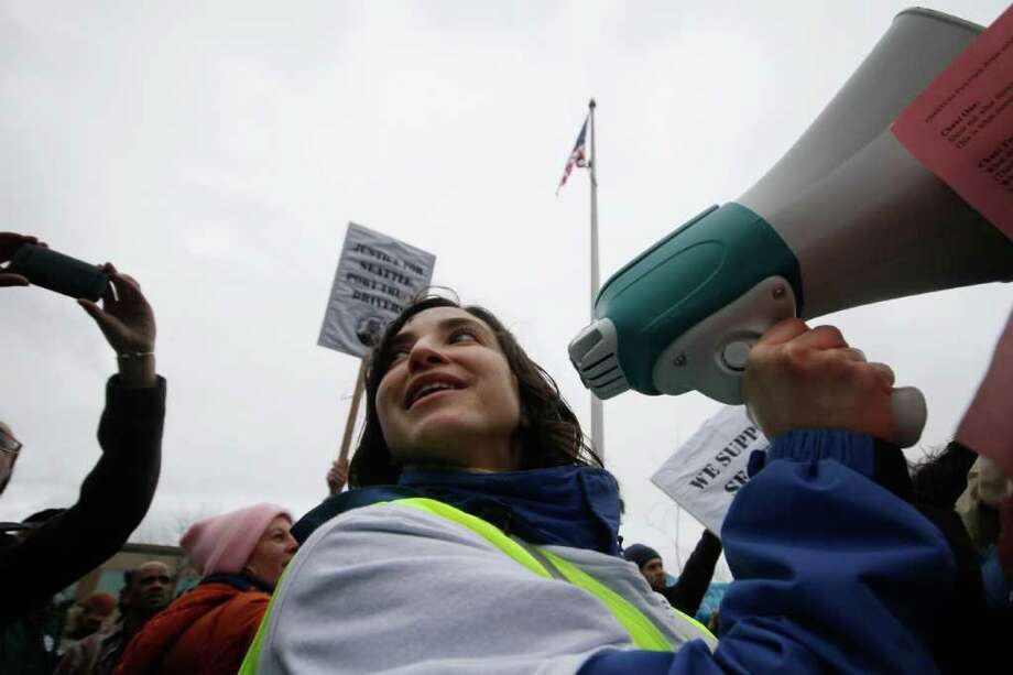 Rebecca Saldana of the Puget Sound Sage Coalition is the new State Senator from Seattle's 37th District.  Here, she cheeers into a microphone during a 2012 rally held below the West Seattle Bridge in Seattle. Hundreds of immigrant truck drivers, community supporters and Muslim, Sikh, and Christian faith leaders rallied near the Spokane Street Bridge Fishing area in Seattle demanding safety & fairness for truck drivers. Photo: Sofia Jaramillo / SEATTLEPI.COM