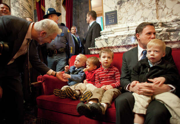 Eric Pedersen, right, partner of Rep. Jaimie Pedersen sits on a couch with their sons, from left, Leif, 2, Erik, 2, Trygve, 4, and Anders, 2, before Governor Chris Gregoire signed a bill legalizing gay marriage in Washington State on Monday February 13, 2012 at the Legislative Building of the Washington State Capitol in Olympia. Photo: JOSHUA TRUJILLO / SEATTLEPI.COM