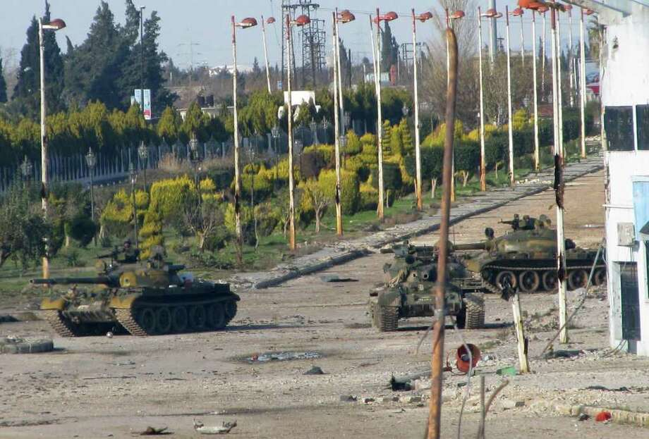 Syrian army tanks were stationed at the entrance to Baba Amr neighbourhood in Homs on Feb. 10. On Monday, Syria ignored a new Arab initiative to end the bloodshed as the assault on Homs continued. Photo: - / AFP