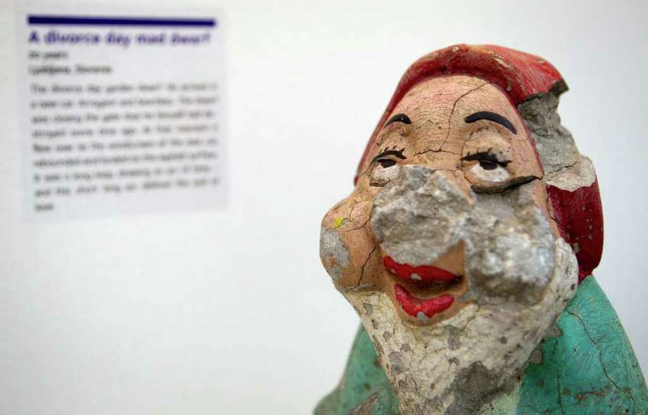 A garden gnome that was hurled at an 'arrogant and heartless' husband is on display at the Museum of Broken Relationships in Zagreb, Croatia. Photo: Darko Bandic / AP