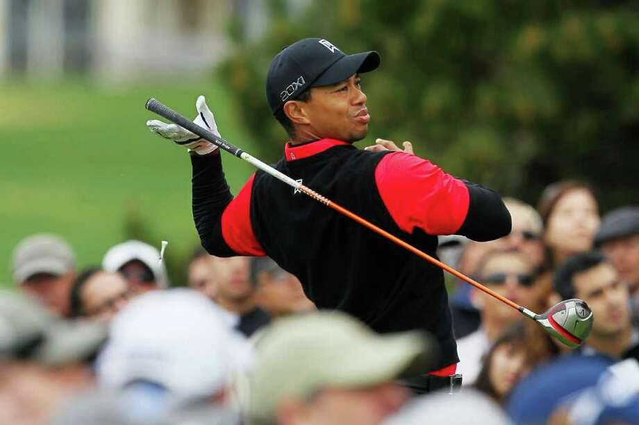 PEBBLE BEACH, CA - FEBRUARY 12:  Tiger Woods lets go of his club as he hits his tee  shot on the tenth hole as a gallery of fans look on during the final round of the AT&T Pebble Beach National Pro-Am at Pebble Beach Golf Links on February 12, 2012 in Pebble Beach, California.  (Photo by Jeff Gross/Getty Images) *** BESTPIX *** Photo: Jeff Gross