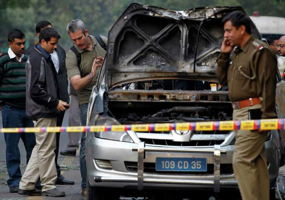In New Delhi, India,  a driver and an Israeli diplomat's wife were injured by a bomb attached to their car. A similar bomb was defused in Tblisi, Georgia. Iran has denied responsibility for the attacks. Photo: Saurabh Das / AP