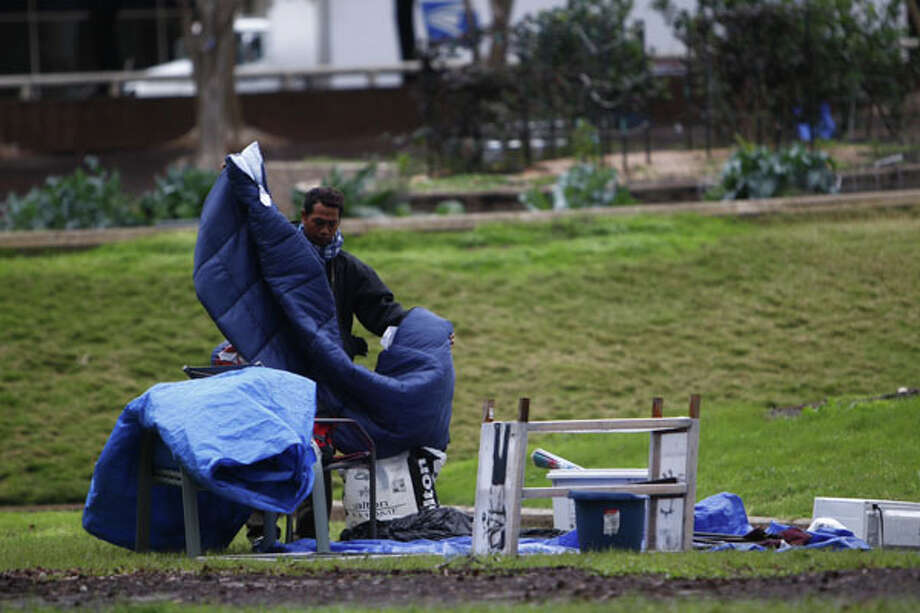 Occupy Houston protesters pack up their site in Tranquillity Park before sundown Monday. (Michael Paulsen / Chronicle) Photo: Michael Paulsen, Houston Chronicle / Houston Chronicle