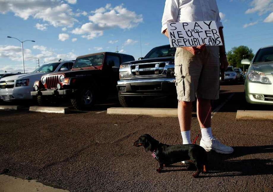 A protester is seen before Republican presidential candidate and former Massachusetts Gov. Mitt Romney speaks at a Get out the Vote Rally. ( Eric Thayer / Getty Images ) Photo: Eric Thayer, Getty Images / 2012 Getty Images