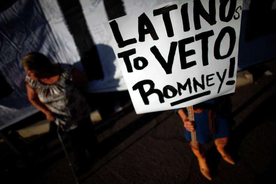 Protesters demonstrate before Republican presidential candidate Mitt Romney attends a Get out the Vote Rally. ( Eric Thayer / Getty Images ) Photo: Eric Thayer, Getty Images / 2012 Getty Images