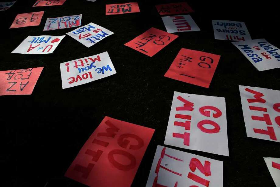 Signs pepper the ground before Republican presidential candidate Mitt Romney attends a Get out the Vote Rally. ( Eric Thayer / Getty Images ) Photo: Eric Thayer, Getty Images / 2012 Getty Images