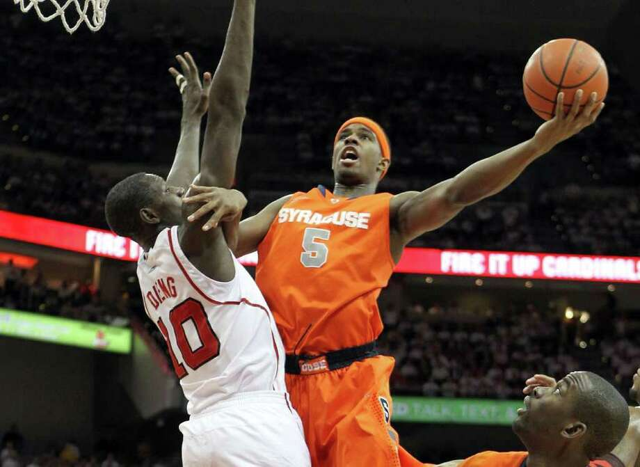 LOUISVILLE, KY - FEBRUARY 13:  C.J. Fair #5 of the Syracuse Orange shoots the ball while defended by Gorgui Dieng #10 of the Louisville Cardinals during the Big East Conference game at KFC YUM! Center on February 13, 2012 in Louisville, Kentucky.  (Photo by Andy Lyons/Getty Images) Photo: Andy Lyons