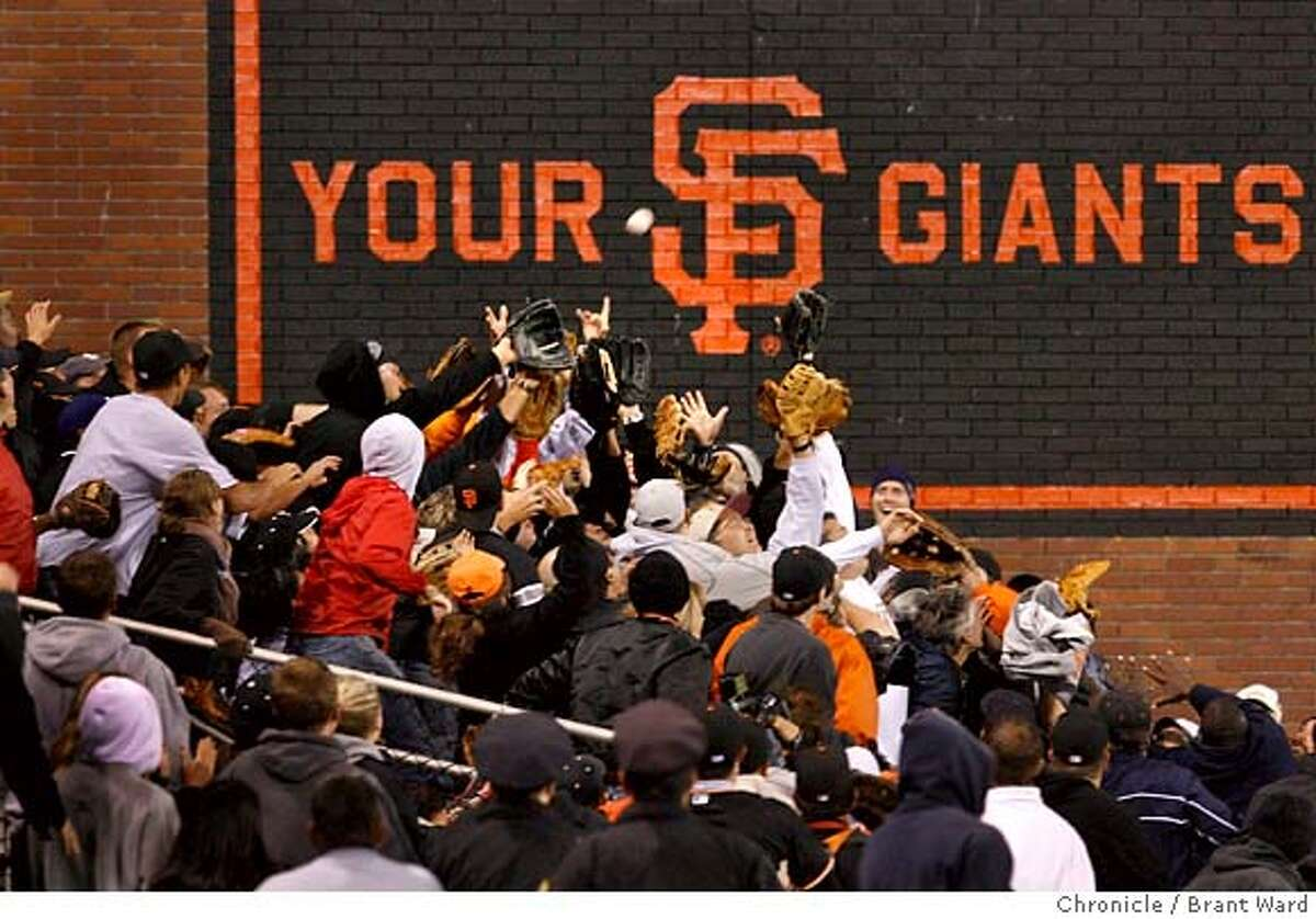 Fans in the left centerfield box got ready to catch Bonds home run ball. Barry Bonds hits hit 756th home run in the 5th inning Tuesday night. SF Giants vs. Washington Nationals. Barry Bonds has 755 home runs at the start of the game, one more needed to break record held by Henry Aaron. {By Brant Ward/San Francisco Chronicle}8/7/07