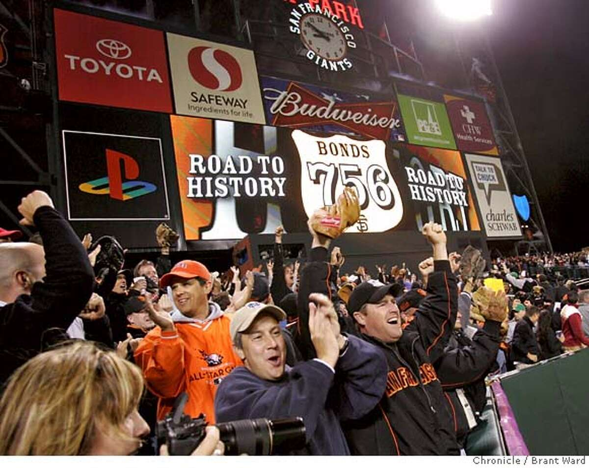 Giants fans in centerfield cheer Bonds famous 756th homer. Barry Bonds hits hit 756th home run in the 5th inning Tuesday night. SF Giants vs. Washington Nationals. Barry Bonds has 755 home runs at the start of the game, one more needed to break record held by Henry Aaron. {By Brant Ward/San Francisco Chronicle}8/7/07