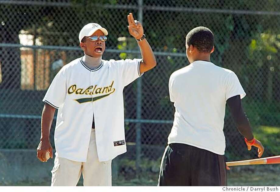 oakkidsbaseball_0008_db.JPG  Coach Roscoe Bryant Jr., left, yells instructions to kids at baseball practice at Lowell Park in West Oakland, in a local baseball program for kids run by Roscoe Bryant Jr. and his wife Lehi Bryant in Oakland, CA, on Thursday, June, 7, 2007. photo taken: 6/7/07  Darryl Bush / The Chronicle ** Roscoe Bryant Jr., Lehi Bryant (cq) Ran on: 08-06-2007  Roscoe Bryant has added a third team of Royals after receiving 600-plus donations. Photo: Darryl Bush