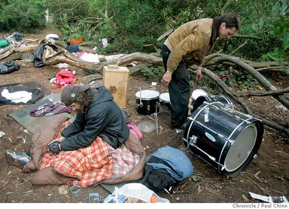 Christopher Ash (right) arranges his drum set as an unidentified neighbor wakes up at a homeless encampment at Golden Gate Park in San Francisco, Calif. on Friday, July 20, 2007. PAUL CHINN/The Chronicle **Christopher Ash MANDATORY CREDIT FOR PHOTOGRAPHER AND S.F. CHRONICLE/NO SALES - MAGS OUT