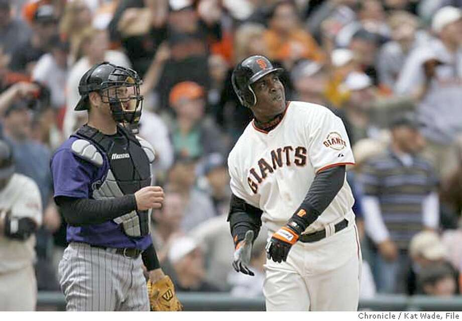 GIANTS_6th_0932_KW.jpg  (L TO R) The Rockies catcher Chris Iannetta watches as The San Francisco Giants Barry Bonds hits his 747th career home run scoring 2 runs in the 6th inning when the Giants lost to the Colorado Rockies in extra innings on Sunday May 27, 2007 at AT&T Park in San Francisco. The Giant's lost 6 to 4 in the 10th inning. Kat Wade/The Chronicle (CQ, subject) Mandatory Credit for San Francisco Chronicle and photographer, Kat Wade, No Sales Mags out Photo: Kat Wade
