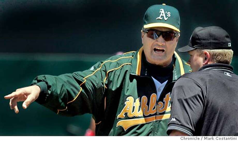 A's manager Bob Geren has a word with umpire Mike Muchlinski after a call at first base in the second inning.  A's beat the Twins at the Coliseum  PHOTO: Mark Costantini / The Chronicle Photo: MARK COSTANTINI