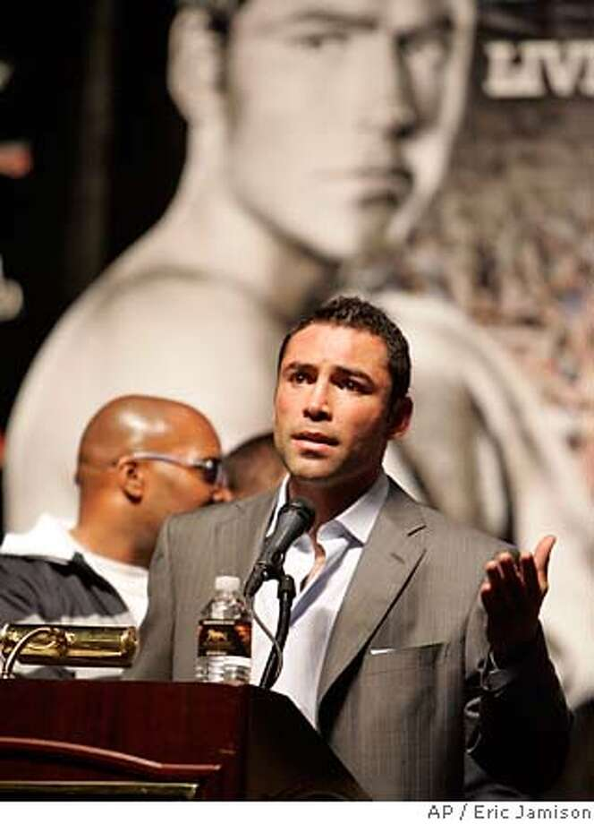 Oscar De La Hoya gestures during a post-fight press conference after losing a split decision to Floyd Mayweather Jr. in their WBC super welterweight world championship boxing match on Saturday, May 5, 2007, at the MGM Grand Garden Arena in Las Vegas. (AP Photo/Eric Jamison) Photo: Eric Jamison