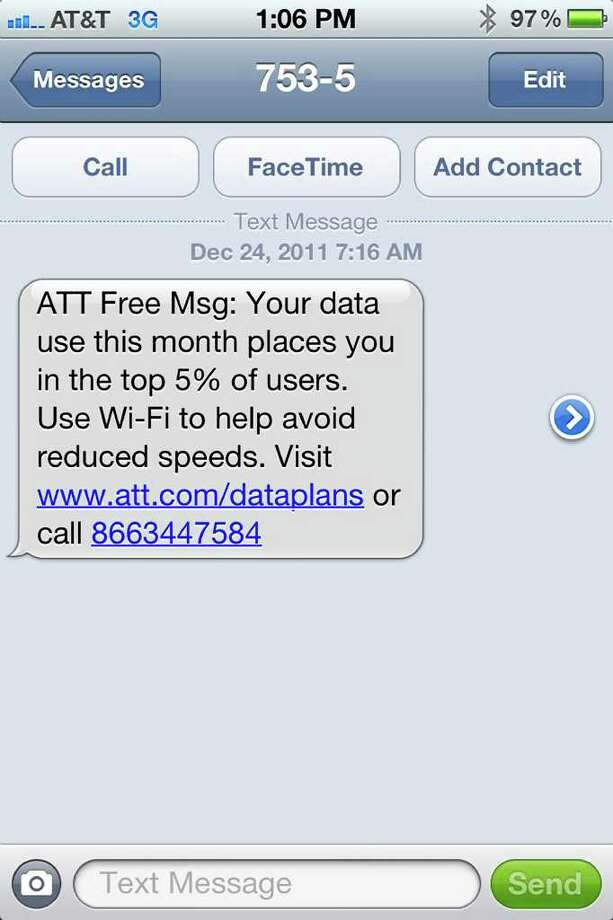 This screen grab shows a warning message on a user's iPhone that he received from AT&T advising he was in danger of having his data speeds throttled. / Mike Trang