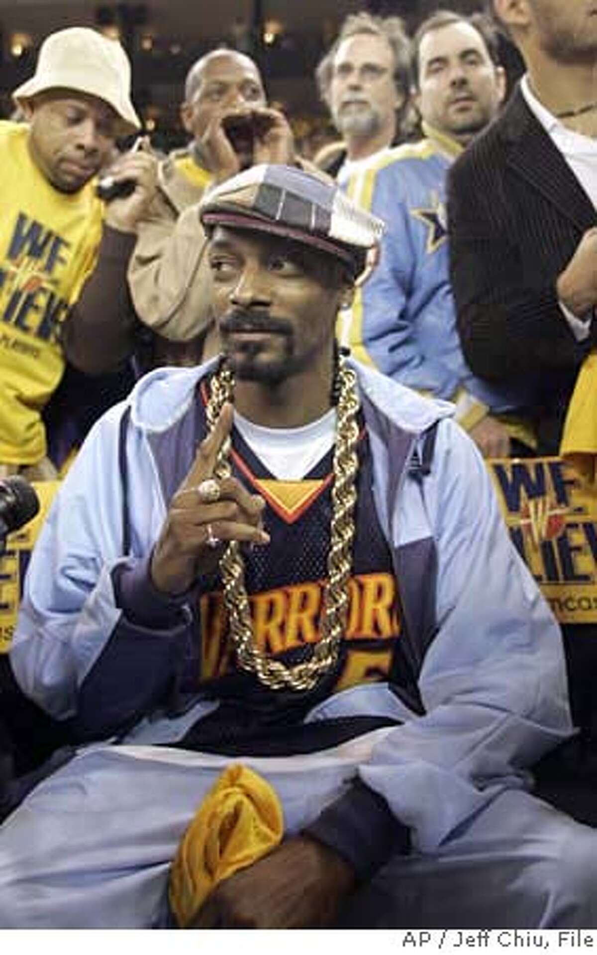 Rapper Snoop Dogg sits courtside before the Dallas Mavericks played the Golden State Warriors' in an NBA Western Conference first-round basketball playoff game in Oakland, Calif., Thursday, May 3, 2007. The Warriors won 111-86.