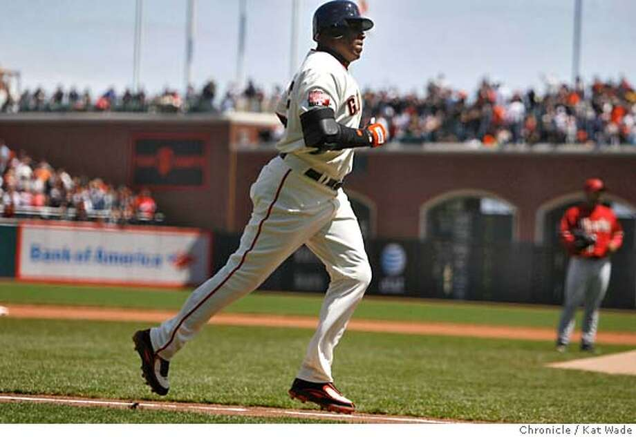 GIANTS_DB_0008_KW.JPG  (L to R)The San Francisco Giant's Barry Bonds heads for home plate when he hits his 740th career homerun, a single run homrrun to right field that gave the Giant's their second run of the game in the 4th inning when the San Francisco Giants beat the Arizona Diamondbacks 2 to 1at AT&T Park Sunday April 22, 2007.  Kat Wade/The Chronicle Mandatory Credit for San Francisco Chronicle and photographer, Kat Wade, No Sales Mags out Photo: Kat Wade