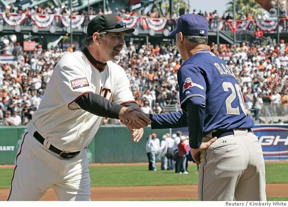 San Francisco Giants manager Bruce Bochy (L) shakes hands with San Diego Padres manager Bud Black before a National League opening day baseball game in San Francisco, California, April 3, 2007. REUTERS/Kimberly White (UNITED STATES) Photo: KIMBERLY WHITE
