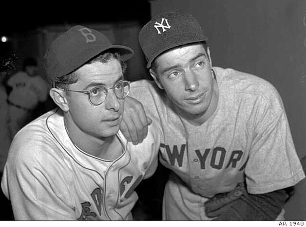 ADVANCE FOR JULY 29-30--FILE--Boston Red Sox' Dominic DiMaggio and older brother Joe, left, pose for a family photo in this April 1940 file photo. Baseball inducts Richie Ashburn into the Hall of Fame on Sunday, a pint-sized center fielder who was a pesky hitter and better than average defensively. Ted Williams thinks DiMaggio ought to be there, too and he intends to do something about it. (AP Photo/file)