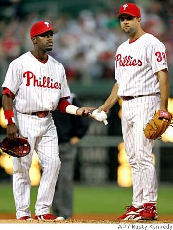Philadelphia Phillies shortstop Jimmy Rollins, left, talks with pitcher Cory Lidle in the third inning of their baseball game against the New York Mets Wednesday, May 10, 2006 in Philadelphia. (AP Photo/Rusty Kennedy)  Ran on: 05-28-2006  Jimmy Rollins  Ran on: 05-28-2006  Jimmy Rollins  Ran on: 05-28-2006 Photo: RUSTY KENNEDY